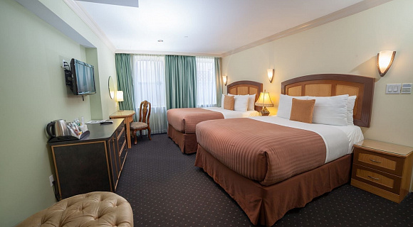 Photo 2 of Deluxe Queen Room with Two Queen Beds and view of the lower west side, and all the standard amenities.