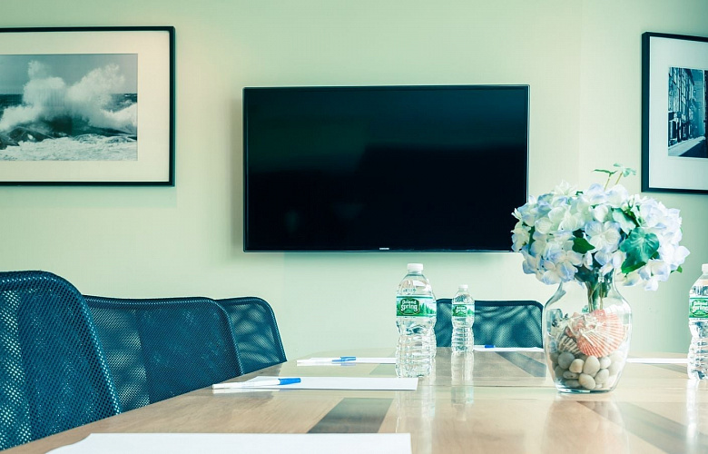 Photo 4 of Meeting Room with a view of NYC that can accommodate up to 8 people and including amenities, such as TV, coffee/tea/water and Wifi.