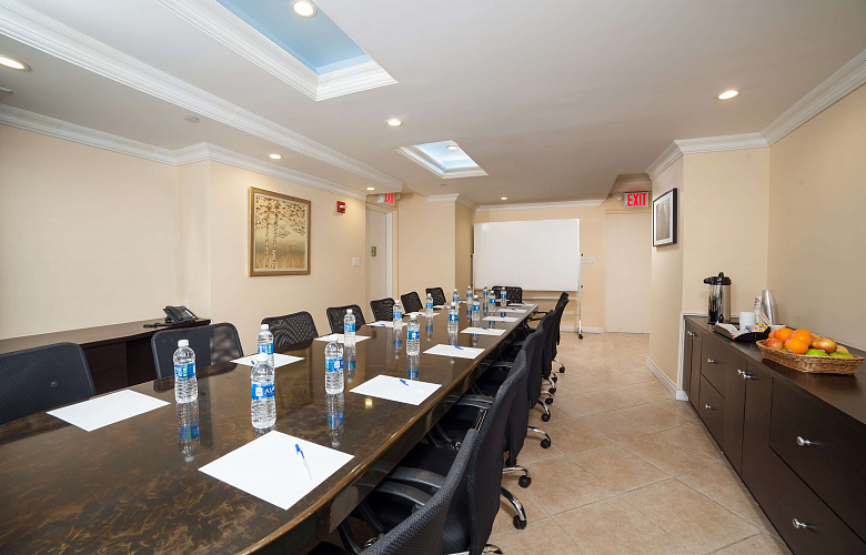 Photo 1 of Private Conference Room that can accommodate up to 15 people with amenities, such as whiteboard, phone, coffee/tea/water and Wifi.