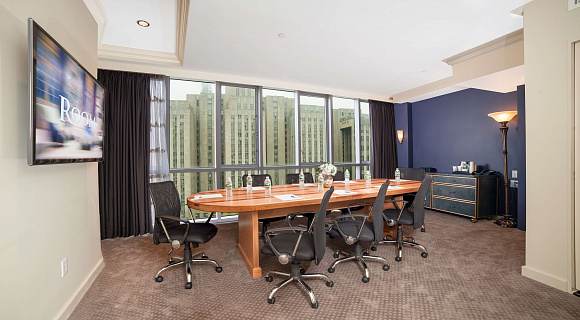 Photo 3 of Meeting Room with a view of NYC that can accommodate up to 8 people and including amenities, such as TV, coffee/tea/water and Wifi.