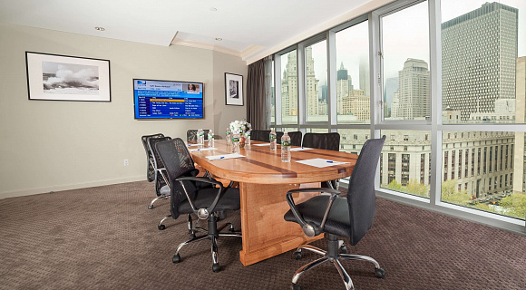 Photo 2 of Meeting Room with a view of NYC that can accommodate up to 8 people and including amenities, such as TV, coffee/tea/water and Wifi.
