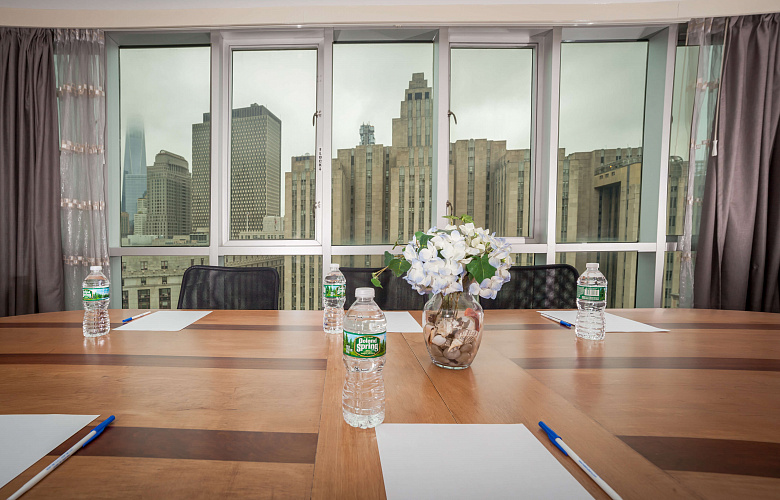 Photo 1 of Meeting Room with a view of NYC that can accommodate up to 8 people and including amenities, such as TV, coffee/tea/water and Wifi.