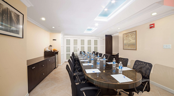 Photo 2 of Private Conference Room that can accommodate up to 15 people with amenities, such as whiteboard, phone, coffee/tea/water and Wifi.