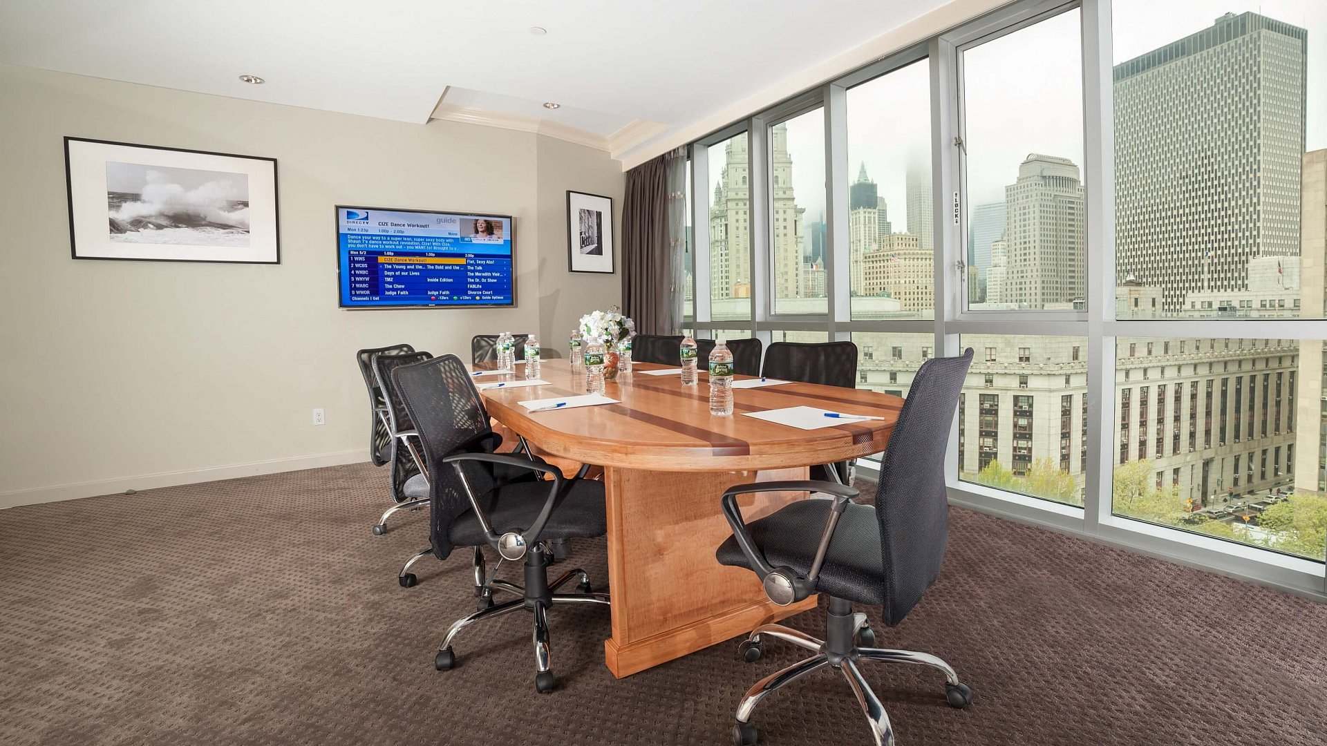 Photo of Meeting Room with a view of NYC that can accommodate up to 8 people.
